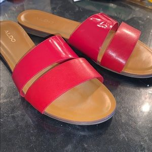Red slide-on Aldo sandals